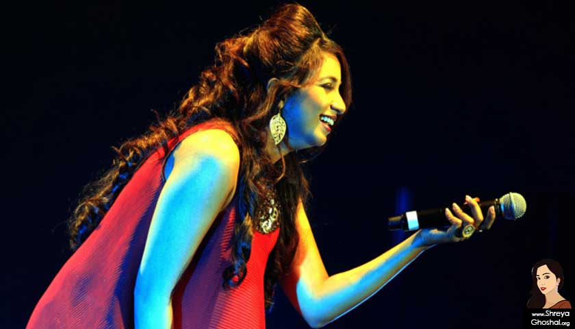 Shreya Ghoshal wearing red
