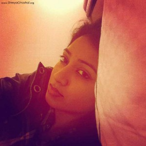 clicked by Shreya Ghoshal - crashed on bed, ready for a quick nap