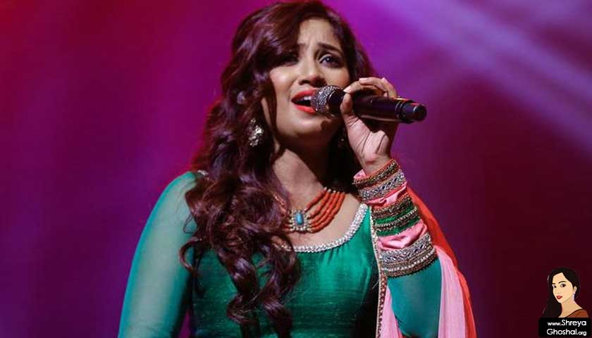 shreya ghoshal, singing in green dress